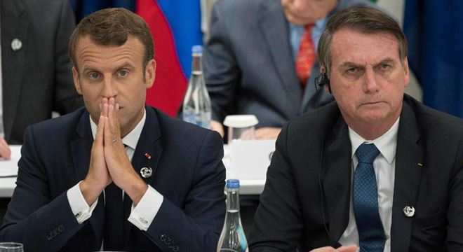 Emmanoel Macron e Jair Bolsonaro — © Jacques Witt